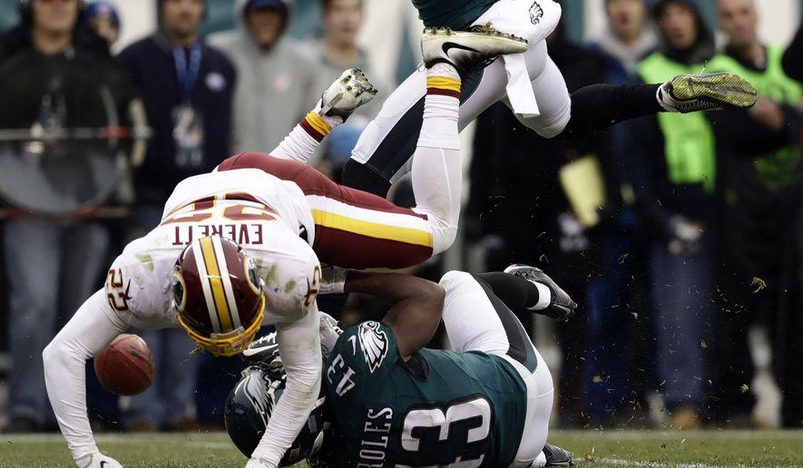 Philadelphia Eagles' Darren Sproles (43) is hit by Washington Redskins' Deshazor Everett (22) on a punt during the second half of an NFL football game, Sunday, Dec. 11, 2016, in Philadelphia. (AP Photo/Matt Rourke)