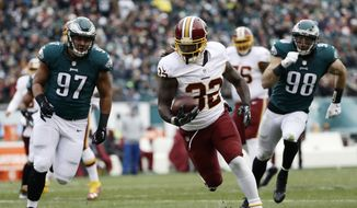 Washington Redskins' Rob Kelley runs for a touchdown during the first half of an NFL football game against the Philadelphia Eagles, Sunday, Dec. 11, 2016, in Philadelphia. (AP Photo/Michael Perez)
