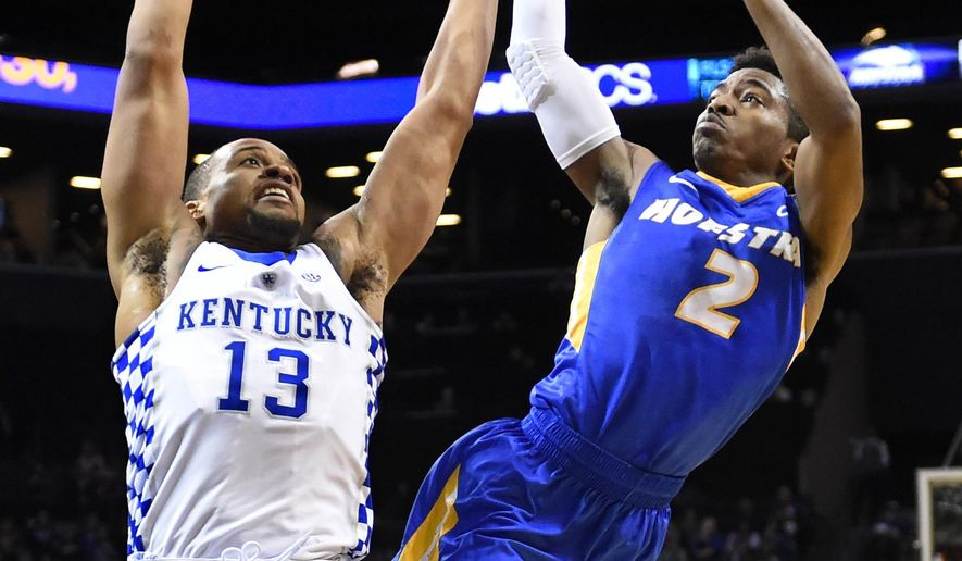 Hofstra guard Deron Powers (2) tries to shoot around Kentucky guard Isaiah Briscoe (13) in the first half of an NCAA college basketball game, Sunday, Dec. 11, 2016, in New York. (AP Photo/Kathy Kmonicek)