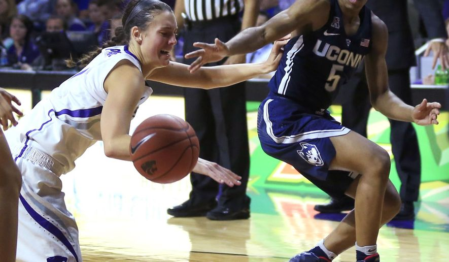 Kansas State forward Kaylee Page (1) and Connecticut guard Crystal Dangerfield (5) make a play for the ball during the second half of an NCAA college basketball game in Manhattan, Kan., Sunday, Dec. 11, 2016. (AP Photo/Orlin Wagner)