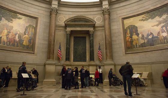 Military veterans visit the Rotunda of the National Archives in 2015, where they can view the original Declaration of Independence, U.S. Constitution, and Bill of Rights. Image courtesy of National Archives and Records Administration.