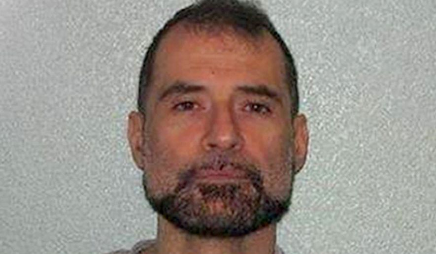This undated handout photo issued by the Metropolitan Police shows Stefano Brizzi, 50. A judge in London has given a crystal meth addict a life term in prison on Monday, Dec. 12, 2016, for killing a police officer during a bondage sex session and then attempting to cook and eat his body parts. Judge Nicholas Hilliard sentenced Stefano Brizzi on Monday to life in prison with at least 24 years to serve for killing 59-year-old Gordon Semple, whose dissolving body was found in an acid bath. (Metropolitan Police via AP)