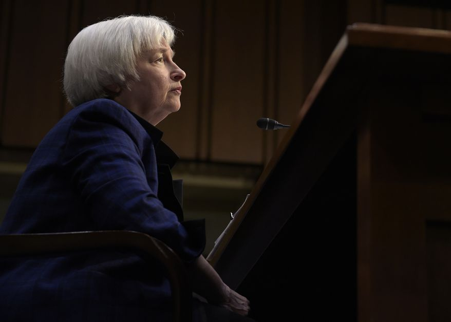 FILE - In this Thursday, Nov. 17, 2016, file photo, Federal Reserve Chair Janet Yellen testifies on Capitol Hill in Washington, before the Joint Economic Committee. A full year after the Federal Reserve raised a key interest rate for the first time in nearly a decade, it is widely expected that they are finally ready to raise rates again at their final meeting of 2016. But the real anticipation revolves around how the central bank plans to respond to the political tsunami that voters have delivered with the election of Donald Trump. (AP Photo/Susan Walsh, File)
