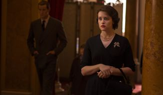 "This image released by Netflix shows Claire Foy (as Queen Elizabeth II)  in a scene from ""The Crown."" The series was nominated for a Golden Globe award for best TV drama on Monday, Dec. 12, 2016. The 74th Golden Globe Awards ceremony will be broadcast on Jan. 8, on NBC. (Netflix via AP)"