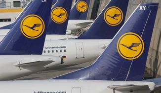 FILE - In this April 2, 2014 file picture Lufthansa aircrafts are parked as Lufthansa pilots went on a three-days-strike in Frankfurt, Germany.  Lufthansa is raising its full-year earnings outlook in light of a strong third-quarter performance and lower oil prices, the company said Thursday Oct. 29, 2015.  (AP Photo/Michael Probst,file)