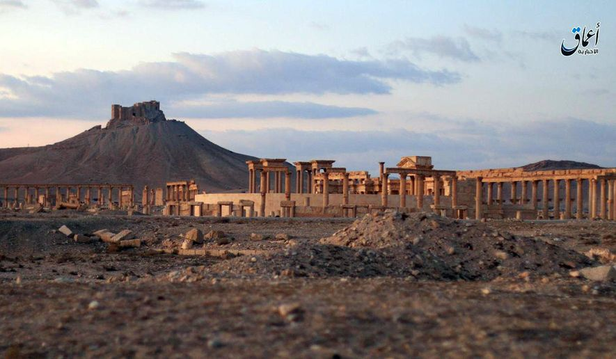 This image posted online on Sunday, Dec. 11, 2016, by the Aamaq News Agency, a media arm of the Islamic State group, purports to show a general view of the ancient ruins of the city of Palmyra, in Homs province, Syria, with the Citadel of Palmyra in the background. (Militant video via AP)