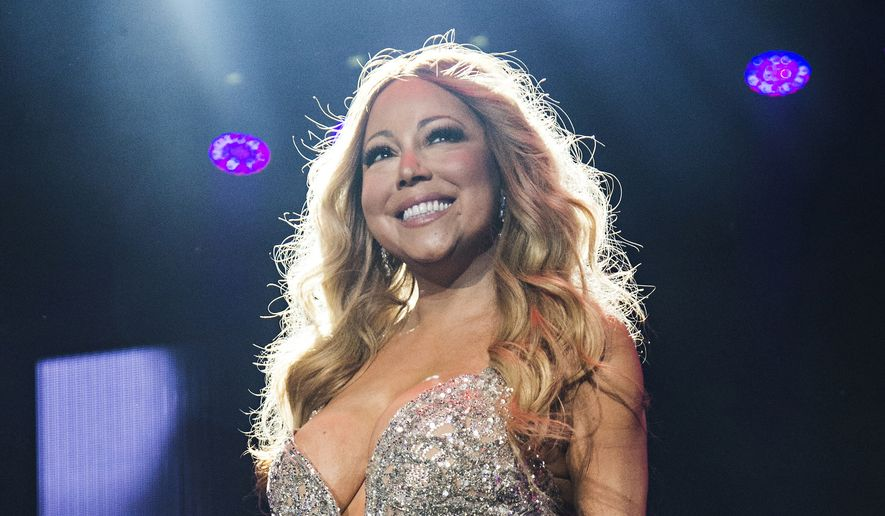This July 2, 2016, file photo shows Mariah Carey at the 2016 Essence Festival in New Orleans. Carey and Lionel Richie announced Monday, Dec. 12, they are joining forces for the All The Hits Tour, which kicks off in Baltimore on March 15, 2017. (Photo by Amy Harris/Invision/AP, File)