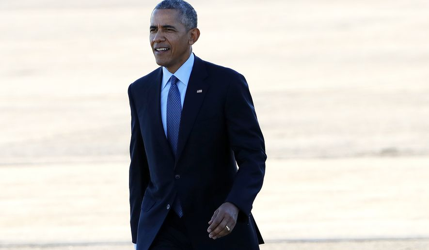 President Barack Obama arrives at Pease Air National Guard Base in Newington, NH, Monday, Nov. 7, 2016. (AP Photo/Winslow Townson)