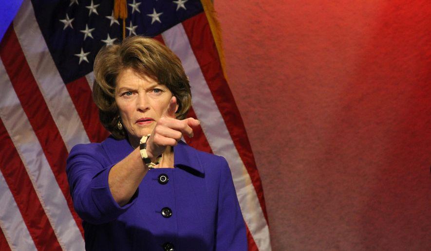U.S. Sen. Lisa Murkowski, R-Alaska, gestures before a public television debate on Thursday, Nov. 3, 2016, in Anchorage, Alaska. She faces three challengers in Tuesday's general election. (AP Photo/Mark Thiessen)