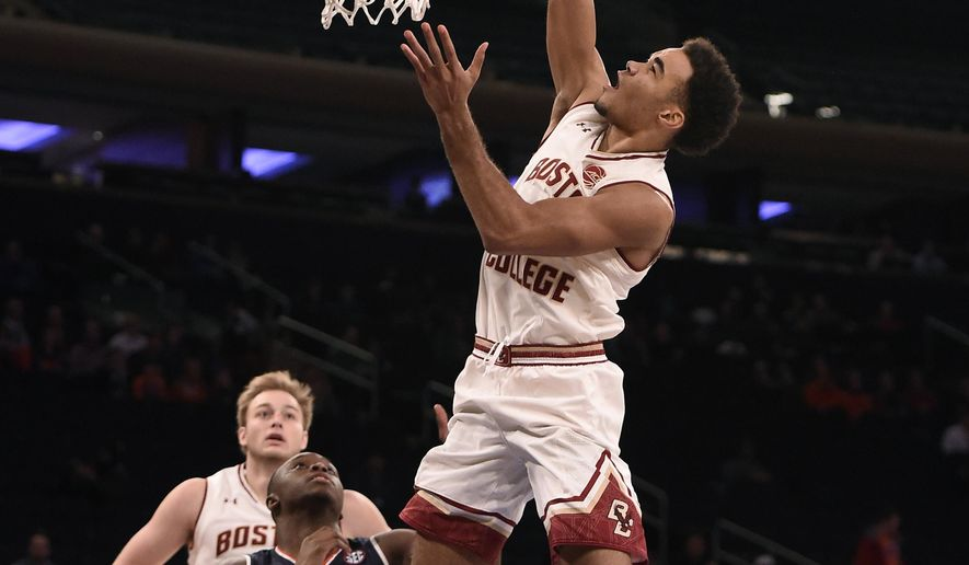 Boston College Jerome Robinson drives the ball to the basket over Auburn guard Mustapha Heron (5) in the first half of an NCAA college basketball game, Monday, Dec. 12, 2016, in New York. (AP Photo/Kathy Kmonicek)