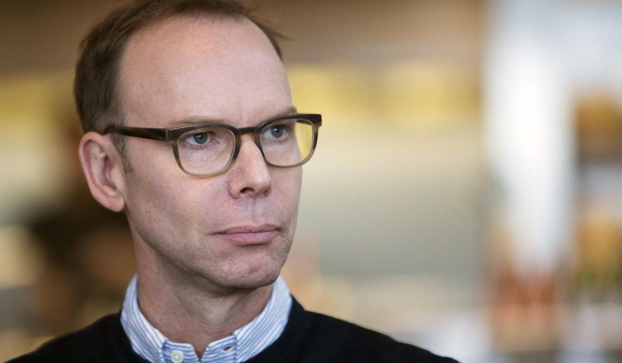 FILE - In this Tuesday, Dec. 15, 2015, file photo, Chipotle Mexican Grill founder and CEO Steve Ells pauses for a moment during an interview with The Associated Press in a Chipotle restaurant in Seattle. On Monday, Dec. 12, 2016, Chipotle Mexican Grill named Ells as the sole CEO of the burrito chain as it fights to recover from a series of food scares. Ells had been co-CEO with Monty Moran, who is stepping down from that position and from his seat on the board of directors. Moran will retire from the company in 2017. (AP Photo/Stephen Brashear, File)