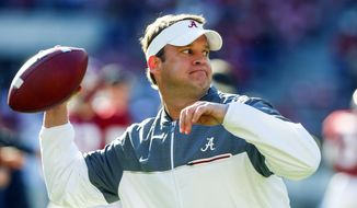 FILE - In this Saturday, Nov. 26, 2016 file photo, Alabama offensive coordinator Lane Kiffin throws a pass during warmups before the Iron Bowl NCAA football game against Auburn  in Tuscaloosa, Ala. Alabama offensive coordinator Lane Kiffin is being pursued by Florida Atlantic to become the Owls' next head coach, two people with knowledge of the situation told The Associated Press on Friday night, Dec. 9, 2016. (AP Photo/Butch Dill, File)