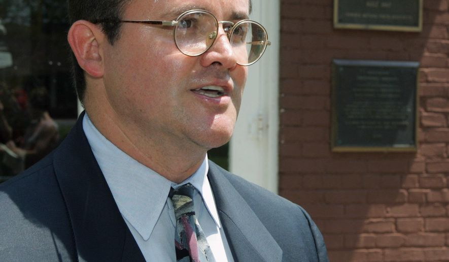 FILE - In this Tuesday, Aug. 2, 2005 file photo, Todd Hembree, the Cherokee Nation's attorney general, talks to the media outside the Cherokee Tribal courthouse in Tahlequah, Okla., Hembree said in an opinion handed down Friday, Dec. 9, 2016, that the tribal statutes that prohibit gay marriage are unconstitutional and that the Oklahoma-based tribe can't refuse to issue a marriage license or recognize a marriage based on the couple's gender. (AP Photo, File)