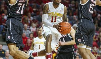 FILE - In this Dec. 5, 2016, file photo, Iowa State guard Monte Morris goes between Nebraska-Omaha guard Zach Jackson and Nebraska-Omaha forward Tre'Shawn Thurman as he looks for an open teammate to pass the ball to during the first half of an NCAA college basketball game, in Ames, Iowa. Iowa State can look like a Final Four contender one game and a team destined for the NIT the next. Coach Steve Prohm's challenge is to find what the Cyclones can do well _ and what they can't _ ahead of Big 12 play. (AP Photo/Justin Hayworth, File)