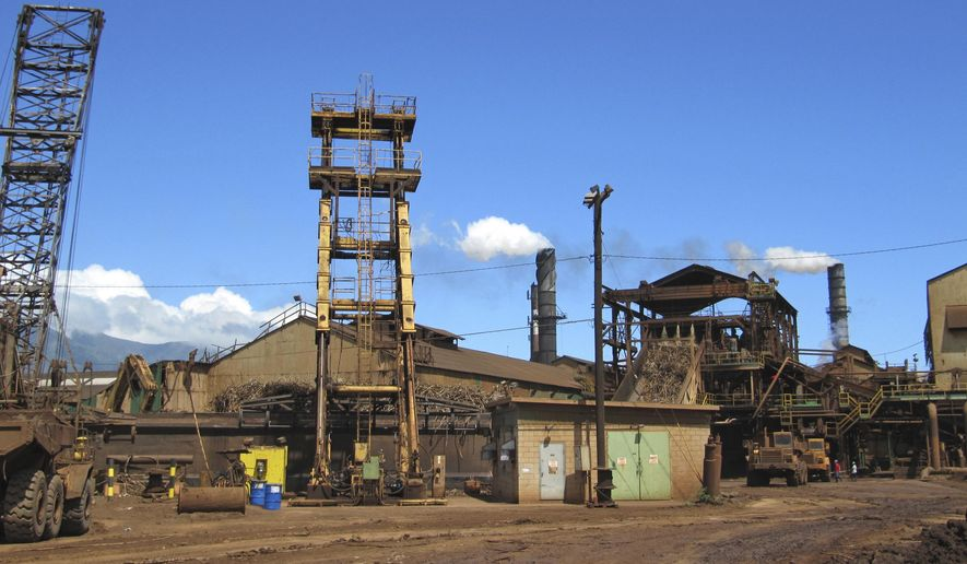 FILE - This April 27, 2010 file photo shows structures on the Hawaiian Commercial & Sugar plantation in Puunene, Hawaii. The only remaining sugar mill in Hawaii is wrapping up its last harvest. The last cane haul at Hawaiian Commercial & Sugar Company on Maui is set to take place Monday, Dec. 12, 2016. Its parent company, Alexander & Baldwin, announced in January that it would phase out sugar production this year. (AP Photo/Audrey McAvoy, File)