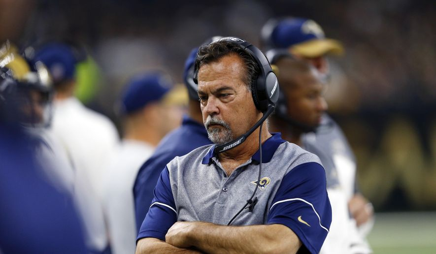 FILE - In this Nov. 27, 2016, file photo, Los Angeles Rams head coach Jeff Fisher reacts on the sideline in the first half of an NFL football game against the New Orleans Saints, in New Orleans. Fisher has been fired Monday, Dec. 12, 2016, by the Los Angeles Rams. The team's coach since 2012, Fisher compiled a 31-45-1 record with the Rams and oversaw the move from St. Louis to Los Angeles this past offseason. The lack of success on the field, capped by a 42-14 home rout at the hands of Atlanta on Sunday, spelled the end for Fisher. (AP Photo/Butch Dill, File)