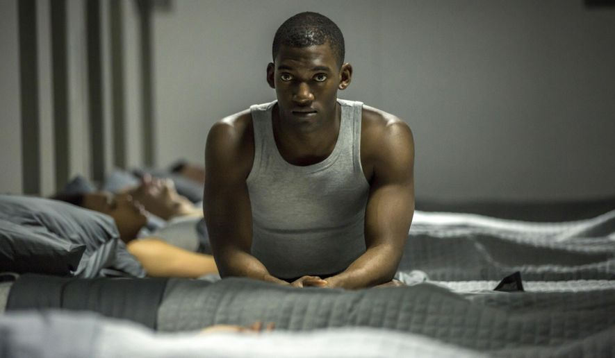 "In this image released by Netflix, Malachi Kirby appears in a scene from, ""Black Mirror."" (Laurie Sparham/Netflix via AP)"