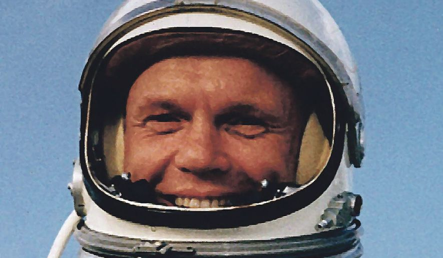 Astronaut John Glenn poses in his Mercury space suit, at Cape Canaveral, Fla., in February 1962, just before his historic three-lap flight around the Earth.   Associated Press photo