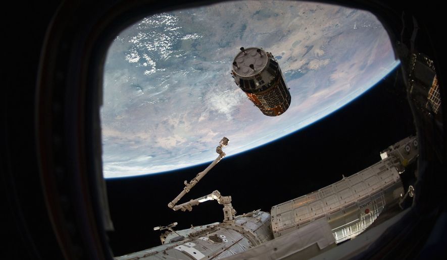 This photo provided by NASA TV shows a Japanese cargo ship before it arrives with Christmas gifts to the International Space Station on Tuesday, Dec. 13, 2016. The capsule  called Kounotori, or white stork  contains nearly 5 tons of food, water, batteries and other supplies. NASA said there also are Christmas presents for the two Americans, three Russians and one Frenchman on board. (NASA TV via AP)