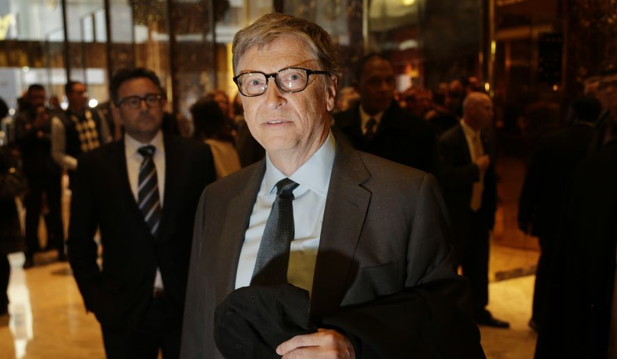 Bill Gates talks to reporters in the lobby of Trump Tower in New York, Tuesday, Dec. 13, 2016. (AP Photo/Seth Wenig)