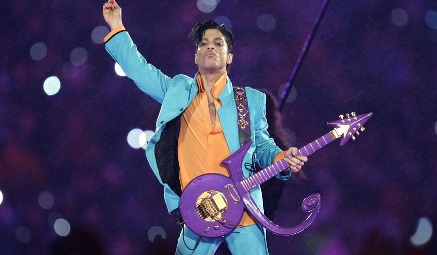 "FILE - In this Feb. 4, 2007 file photo, Prince performs during the halftime show at the Super Bowl XLI football game at Dolphin Stadium in Miami. Widely acclaimed as one of the most inventive and influential musicians of his era with hits including ""Little Red Corvette,"" ''Let's Go Crazy"" and ""When Doves Cry,"" he was found dead at his home on Thursday, April 21, 2016, in suburban Minneapolis, according to his publicist. He was 57. (AP Photo/Chris O'Meara, File)"