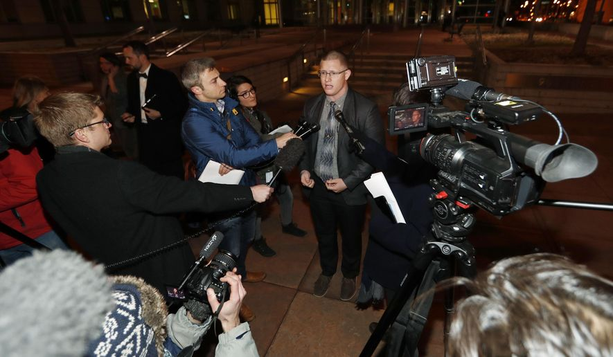 Michael Baca, center, speaks after arguments in a lawsuit were heard Monday, Dec. 12, 2016, outside the federal courthouse in downtown Denver. Baca and a Democratic elector are trying to be freed of Colorado's requirement that they vote for the winner of the state's popular vote in the presidential election this past November. (AP Photo/David Zalubowski)