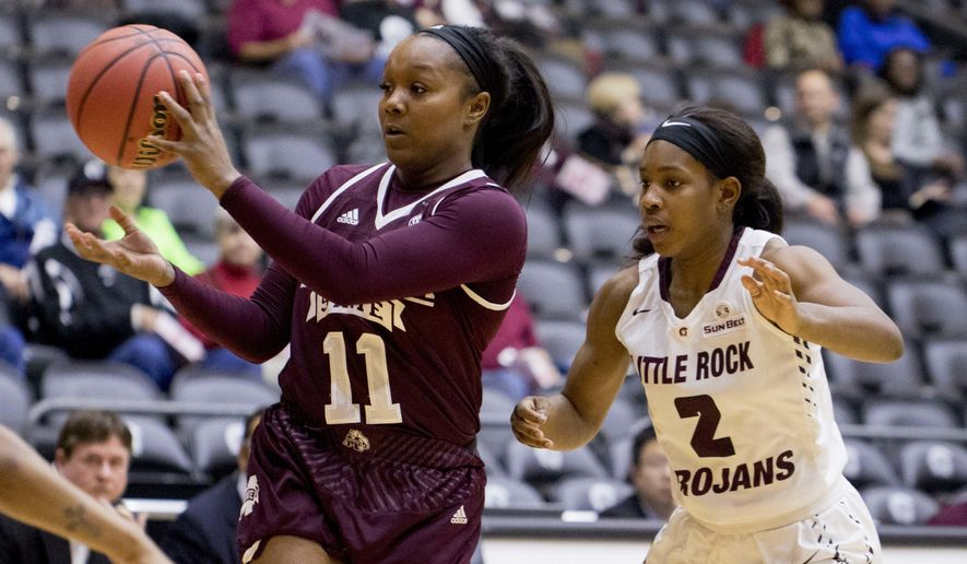 Mississippi State guard Roshunda Johnson (11) passes the ball as UALR guard Monique Townson (2) defends during the first period of an NCAA college basketball game Tuesday, Dec. 13, 2016, in Little Rock, Ark. (AP Photo/Gareth Patterson)