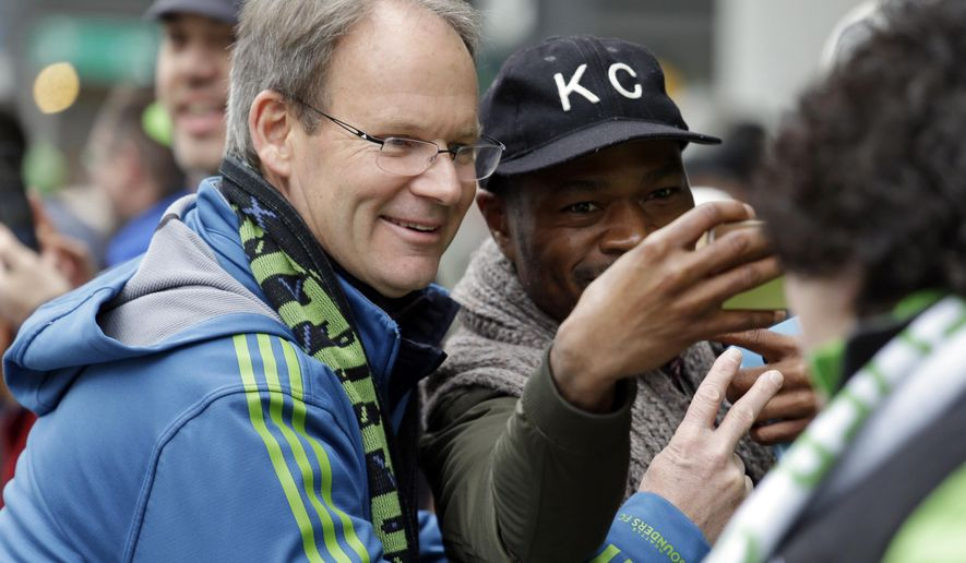 Seattle Sounders head coach Brian Schmetzer smiles for a photo before a march and rally celebrating the team's MLS Cup Championship Tuesday, Dec. 13, 2016, in Seattle. Seattle beat Toronto FC 5-4 in a penalty kick shootout Saturday to win their first MLS championship. (AP Photo/Elaine Thompson)