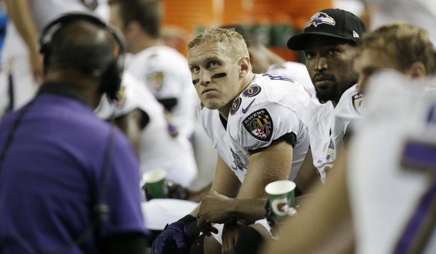 FILE - In this Sept. 3, 2015, file photo, Baltimore Ravens tight end Konrad Reuland (86) sits on the bench during the second half of an NFL football preseason game against the Atlanta Falcons, in Atlanta. The Baltimore Ravens say former tight end Konrad Reuland has died at the age of 29 following a brain aneurism. A Ravens spokesman says Reuland's mother informed the team that he died Monday, Dec. 12, 2016. (AP Photo/Brynn Anderson, File)