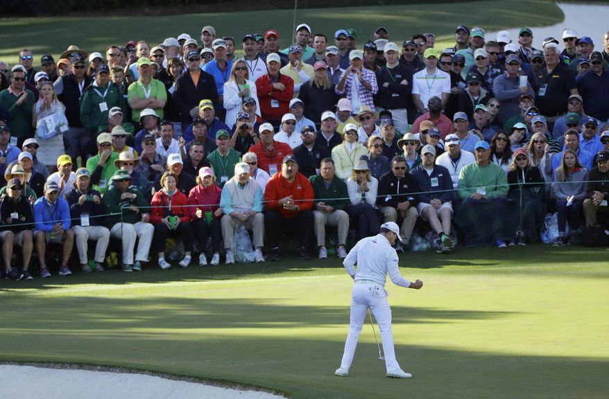 FILE - In this April 10, 2016, file photo, Danny Willett, of England, pumps his fist after a birdie putt on the 16th green during the final round of the Masters golf tournament in Augusta, Ga. It was the most significant shot of Willett's victory in the Masters. (AP Photo/Jae C. Hong, File)