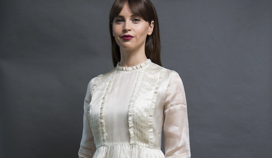 """In this Dec. 4, 2016 photo, Felicity Jones, who plays Jyn Erso in """"Rogue One: A Star Wars Story,"""" poses for a photo in San Francisco. (Photo by Peter Barreras/Invision/AP)"""