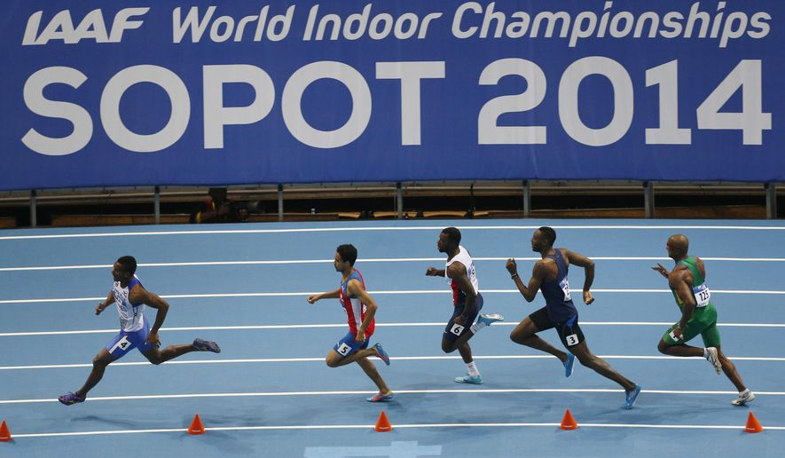 FILE - In this Friday, March 7, 2014 file photo athletes run in a Men's 400m heat during the Athletics World Indoor Championships in Sopot, Poland. The IAAF says it may reanalyze Russian doping samples from the 2014 world indoor track championships. (AP Photo/Petr David Josek, File)