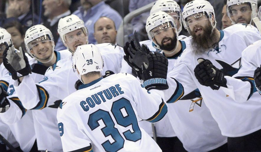 San Jose Sharks center Logan Couture (39) is congratulated after scoring in the second round of the shootout in an NHL hockey game in Toronto on Tuesday, Dec. 13, 2016. (Frank Gunn/The Canadian Press via AP)