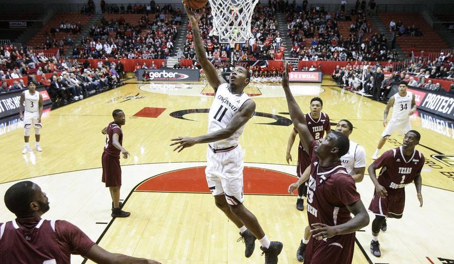 Cincinnati's Gary Clark (11) shoots as Texas Southern's Derrick Griffin (23) looks on in the first half an NCAA college basketball game, Tuesday, Dec. 13, 2016, in Cincinnati. (AP Photo/John Minchillo)