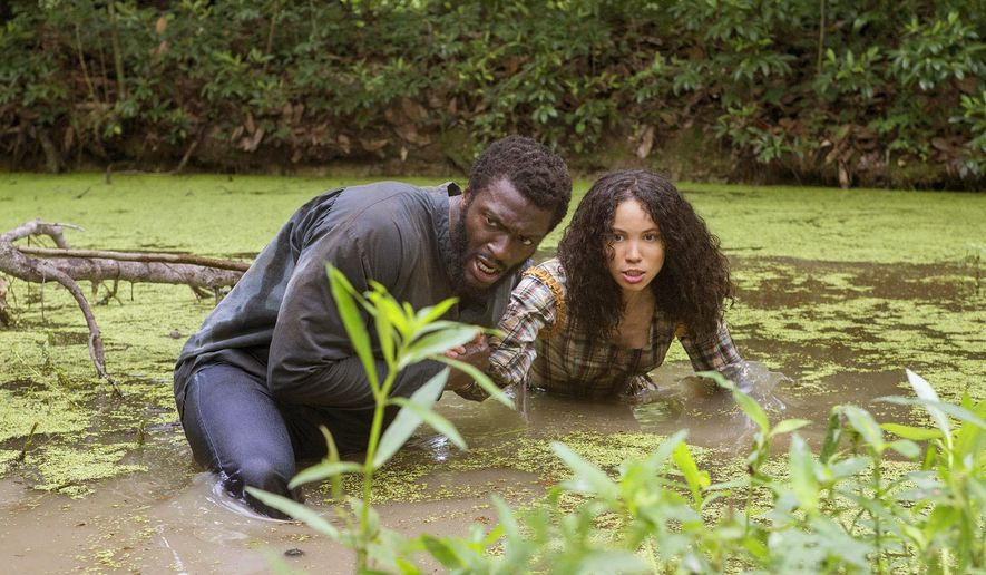 "This image released by WGN shows Aldis Hodge, left, and urnee Smollett-Bell in a scene from ""Underground."" WGN America's drama ""Underground"" is set to premiere its second season on March 8, 2017.  Set in a divided America on the brink of the Civil War, the 10-episode season will add to the cast Aisha Hinds playing abolitionist Harriet Tubman as its characters continue their underground journey to freedom. (Skip Bolen/Sony Pictures Television via AP)"