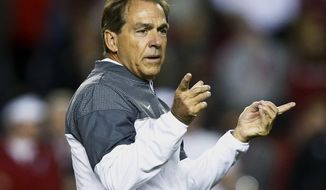 FILE - In this Nov. 19, 2016, file photo, Alabama head coach Nick Saban gestures towards his players before an NCAA college football game against Chattanooga,  in Tuscaloosa, Ala. The Associated Press has been selecting a college football coach of the year since 1998. The 2016 winner will be announced Thursday, Dec. 15, 2016. (AP Photo/Brynn Anderson, File)
