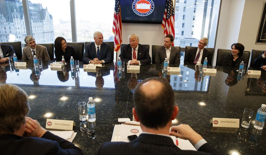 President-elect Donald Trump speaks during a meeting with technology industry leaders at Trump Tower in New York, Wednesday, Dec. 14, 2016. From left are, Alphabet CEO Larry Page, Facebook COO Sheryl Sandberg, Vice President-elect Mike Pence, Trump, PayPal founder Peter Thiel, Apple CEO Tim Cook, and Oracle CEO Safra Catz. (AP Photo/Evan Vucci)