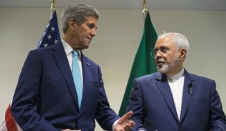 In this Sept. 26, 2015, file photo, Secretary of State John Kerry meets with Iranian Foreign Minister Mohammad Javad Zarif at United Nations headquarters. (AP Photo/Craig Ruttle, File)