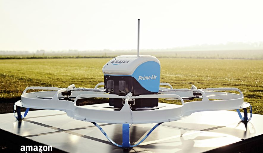 This Dec. 7, 2016, photo provided by Amazon shows an Amazon Prime Air drone in Cambridgeshire, United Kingdom. Amazon announced the successful delivery of a package by drone to a customer in Cambridge, U.K., part of a small testing program. With drones, Amazon aims to make deliveries in 30 minutes or less. Packages must weigh five pounds or less and can only be delivered during the day and in clear weather. Amazon plans to expand the trial to hundreds of users. (Amazon via AP)