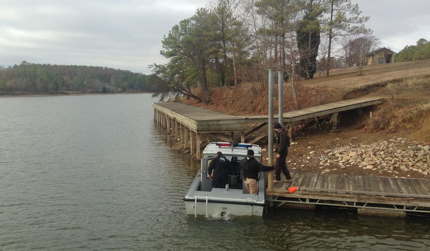 Alabama State Troopers arrive, Wednesday, Dec. 14, 2016,  to search for a missing victim after a vehicle drove off a boat landing Tuesday in northeastern Alabama at Leesburg Landing in Cherokee County, Ala. An official says four people are dead and that crews are searching for a fifth person.  (William Thornton/AL.com via AP)