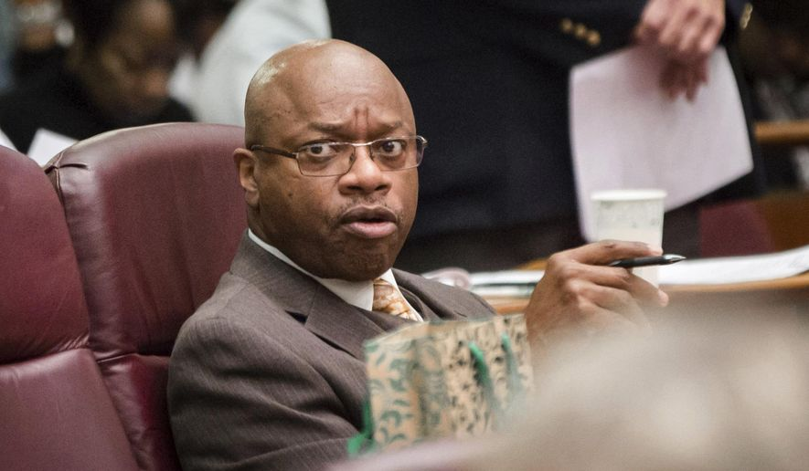 Chicago Alderman Willie Cochran attends a city council meeting Wednesday, Dec. 14, 2016, in Chicago. Cochran has been indicted on charges that he extorted money from a liquor store owner and pilfered funds from a local government activities fund to pay for gambling and his daughter's college tuition. The indictment was filed Wednesday in U.S. District Court in Chicago. (Santiago Covarrubias/Chicago Sun-Times via AP)