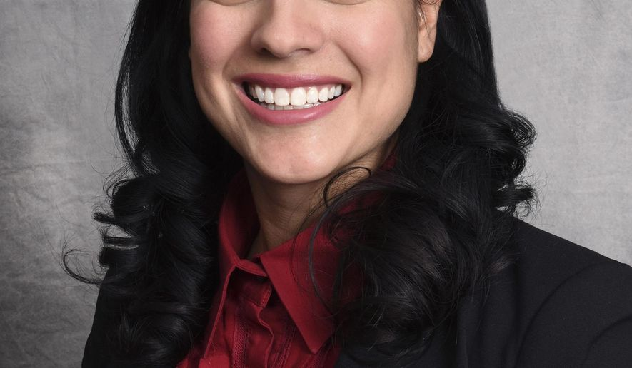 This Dec. 13, 2016 photo provided by the City of Chicago shows the next city clerk, Anna Valencia. Chicago Mayor Rahm Emanuel appointed Valencia, a 31-year-old director in his administration Wednesday, Dec. 14, 2016, as the next city clerk after former Clerk Susana Mendoza was sworn in as Illinois comptroller this month. (City of Chicago via AP)