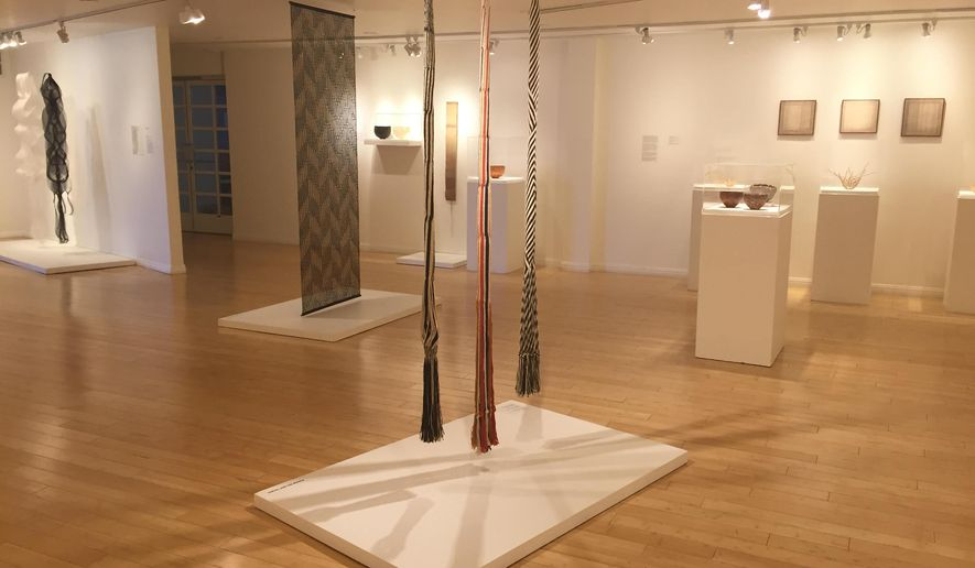 "This photo taken on Dec. 2, 2016 at the Craft and Folk Art Museum in Los Angeles shows part of the ""Kay Sekimachi: Simple Complexity"" exhibit there, chronicling the decades-long career of Berkeley, Calif., based 90-year-old fiber artist and weaver Kay Sekimachi. The exhibit opened on Sept. 25, 2016, and runs through Jan. 8, 2017. (Solvej Schou via AP)"