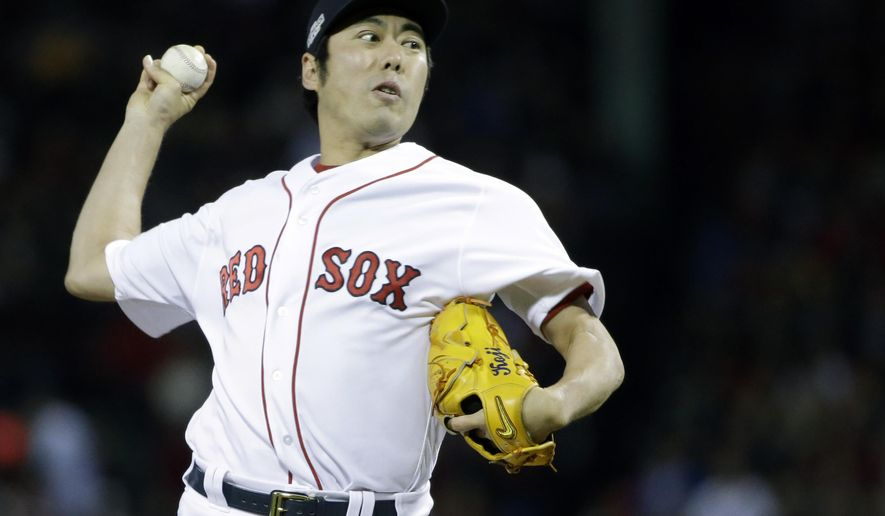 FILE - In this Oct. 10, 2016, file photo, Boston Red Sox relief pitcher Koji Uehara delivers against the Cleveland Indians during the eighth inning in Game 3 of baseball's American League Division Series, in Boston. A person familiar with the situation says the Chicago Cubs and reliever Koji Uehara have agreed to a $6 million, one-year contract. The person spoke Wednesday, Dec. 14, 2016, on the condition of anonymity because the deal has not been announced. (AP Photo/Elise Amendola, File)