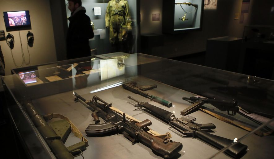 Real-life spy gadgets and weapons of secret agents around the world are displayed as part of the 'Secret Wars' exhibition at Invalides Museum, in Paris, Monday, Dec. 12, 2016. 'Secret Wars' displays about 400 objects, devices and archives from World War I to the end of the Cold War of French, British, American and German collections, most of which have never been shown before. (AP Photo/Francois Mori)