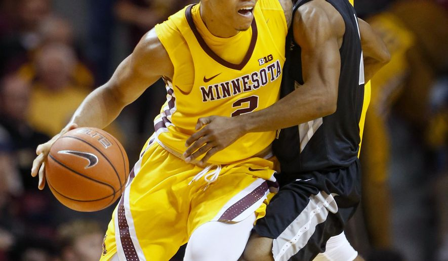LIU Brooklyn guard Jashaun Agosto (2) fouls Minnesota guard Nate Mason (2) as he dribbles in the first half of an NCAA college basketball game Wednesday, Dec. 14, 2016, in Minneapolis. (AP Photo/Bruce Kluckhohn)