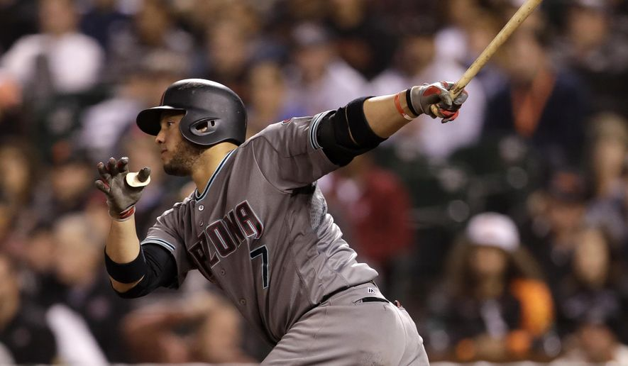 FILE - In this Aug. 30, 2016, file photo, Arizona Diamondbacks' Welington Castillo watches his two-run single during the fifth inning of a baseball game against the San Francisco Giants, in San Francisco. The Baltimore Orioles say they have reached a contract agreement with free agent catcher Welington Castillo, pending a medical review. (AP Photo/Marcio Jose Sanchez, FIle)