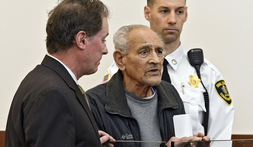 Ralph DeMasi enters his not guilty plea during his arraignment in the 1991 shooting death of armored truck guard, Edward P. Morlock Sr., Wednesday, Dec. 14, 2016, in Worcester Superior Court in Worcester, Mass. At left is DeMasi's attorney, Michael Hussey. (Christine Hochkeppel/Worcester Telegram & Gazette via AP)