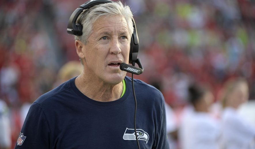 This Nov. 27, 2016 photo shows Seattle Seahawks head coach Pete Carroll walking the sideline prior to the start of an NFL football game against the Tampa Bay Buccaneers in Tampa, Fla. Seattle can wrap up its third NFC West title in the past four seasons with a win over the listless Los Angeles Rams on Thursday, Dec. 15, 2016. (AP Photo/Phelan M. Ebenhack)