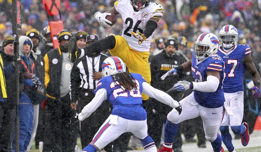 FILE - In this Dec. 11, 2016, file photo, Pittsburgh Steelers running back Le'Veon Bell (26) leaps over Buffalo Bills cornerback Ronald Darby (28) during the second half of an NFL football game, in Orchard Park, N.Y. The do-everything running back has thrust himself into the MVP conversation during a torrid month-long tear that's pushed the Steelers back atop the AFC North. (AP Photo/Bill Wippert, File)